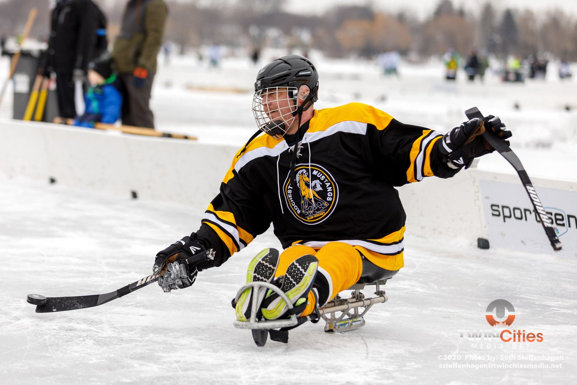 January 26, 2020 - Minneapolis, Minnesota, United States - Rochester Mustangs Gold take on Rochester Mustangs Black in the sled hockey championship game during the U.S. Pond Hockey Championships on Lake Nokomis.   (Photo by Seth Steffenhagen/Steffenhagen Photography)