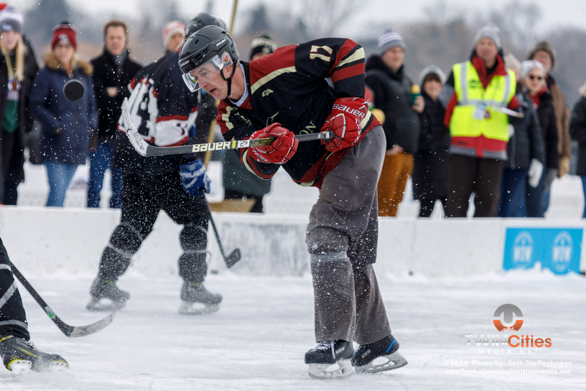 January 26, 2020 - Minneapolis, Minnesota, United States -  Tradition Mortgage play Wright Homes/4 Star for the 40+ Open championship during the U.S. Pond Hockey Championships on Lake Nokomis.   (Photo by Seth Steffenhagen/Steffenhagen Photography)
